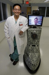 "** HOLD FOR STORY BY MICHELLE ROBERTS ** Dr. Kevin Chung poses with a medical robot, nicknamed the ""Chungbot,"" at Brooke Army Medical Center in San Antonio, Monday, Aug. 17, 2009. The robot is controlled with a laptop and joystick and wirelessly transmits images and sound between the user and the patient, allowing for follow-up from around the world or quick diagnosis from a far-off specialist. (AP Photo/Eric Gay)"
