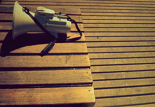 megaphone-on-wooden-slats